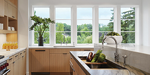 Kitchen within a finished home with replacement windows