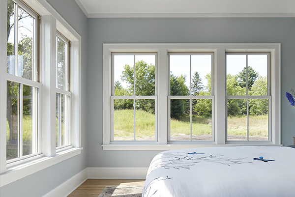 Window installation guide with bedroom full of finished newly installed windows
